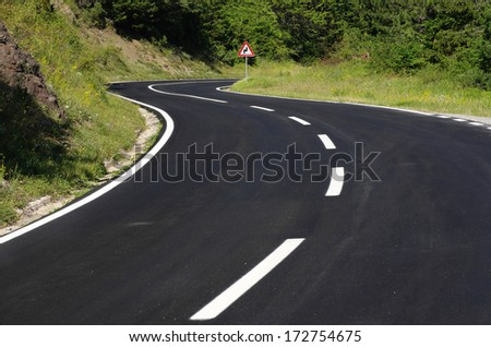 winding road black asphalt - stock photo