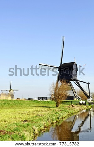 windmill in beautiful dutch landscape