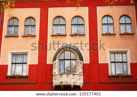windows on a residential building in the old town - stock photo