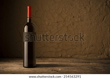 wine bottle  on wooden barrel - stock photo
