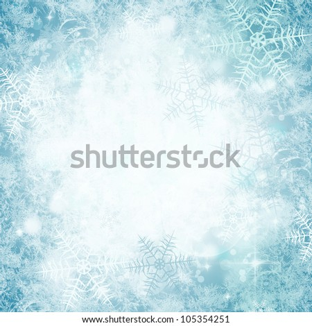 winter abstract background with bokeh lights, snowflakes and stars - stock photo