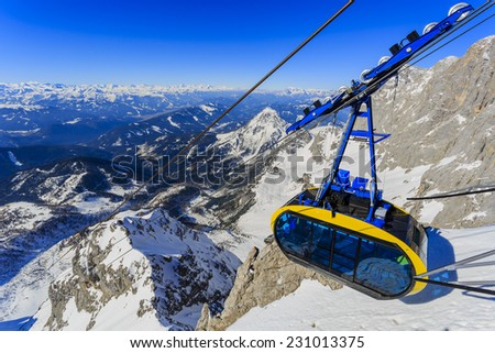 Winter mountains, cable car, ski lift - Austrian Alps - stock photo