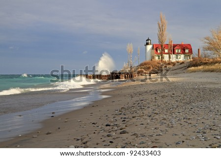 """Winter's Coming"" -- Point Betsie Lighthouse, Gail waves -- Crystallia, Michigan, USA - stock photo"