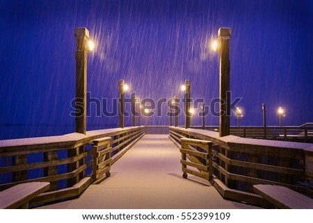 Winter Snow, Fishing Pier, Richmond, BC. A snow storm blankets a fishing pier on the bank of the Fraser River near Steveston at twilight.