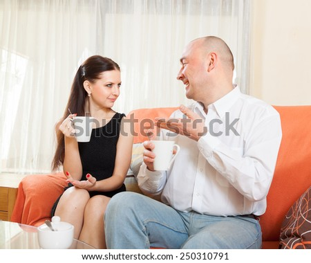 Woman and man   talking over   cup of tea.