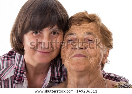woman and senior mother at home - stock photo