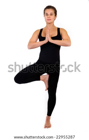 woman doing yoga pose.  Isolated on white background. - stock photo