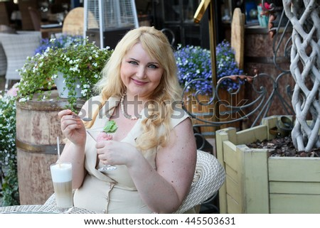 woman eating ice cream in restaurant