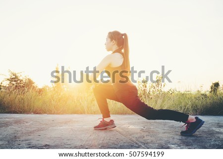 Woman exercise outdoor in Sunset