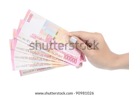 woman hand carrying money Indonesia, isolated on white background