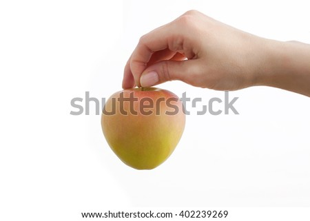 Woman hands with natural manicure hold apple isolated on white background