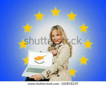 woman holding laptop with cyprus flag on the screen and european union stars in the background - stock photo