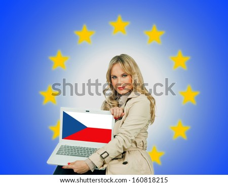 woman holding laptop with czech republic flag on the screen and european union stars in the background - stock photo