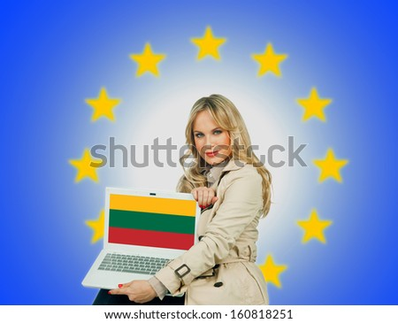 woman holding laptop with lithuanian flag on the screen and european union stars in the background - stock photo