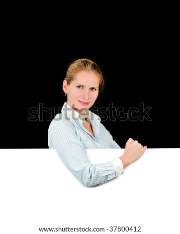 Woman holding the blank billboard isolated on black background - stock photo