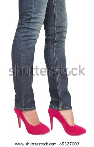 Woman in hot pink red high heels and jeans. closeup of lower half body isolated on white background. - stock photo