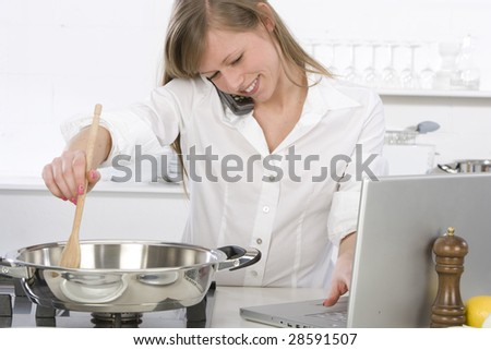 woman in the kitchen with computer - stock photo