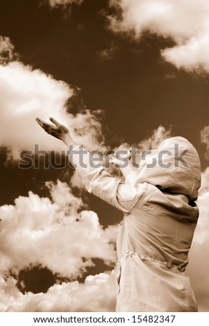 Woman in worship position - stock photo