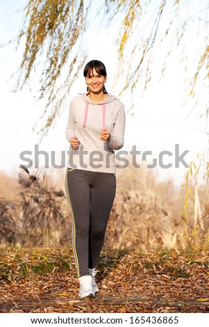 Woman jogging outdoors. Healthy lifestyle, fitness, jogging, active, young concept. - stock photo