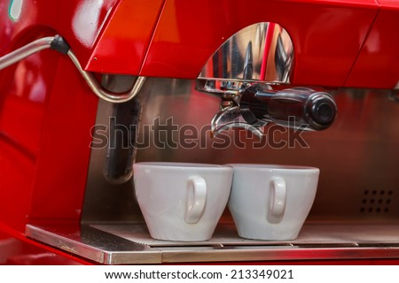 Woman making cup of cappuccino coffee - stock photo