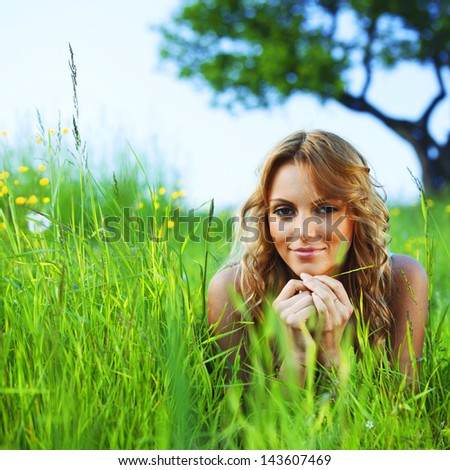woman on the green grass under tree happy and smile - stock photo