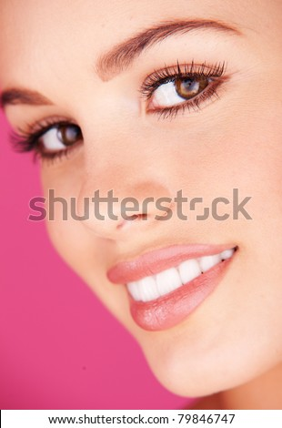 woman portrait with a white healthy teeth  on pink background - stock photo
