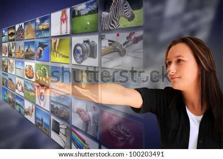Woman pressing a virtual screen button - stock photo