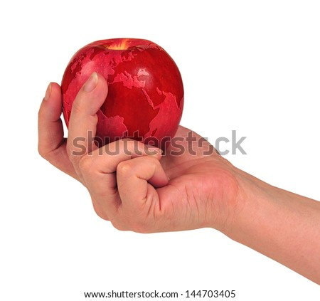 """woman's hand holding a red apple with the map of the world   """