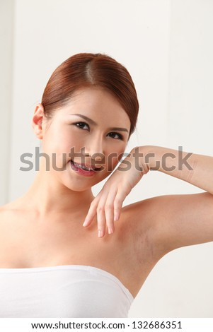 Woman Touching Her Face on the white background - stock photo