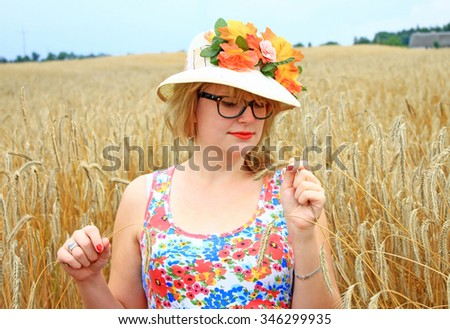 Woman touching in hands golden wheat field, happy farmer enjoying great harvest, agricultural industry, autumn season concept  - stock photo