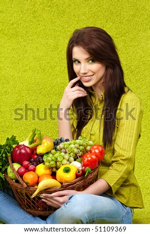 Woman with fruits and vegetables . Spring concept