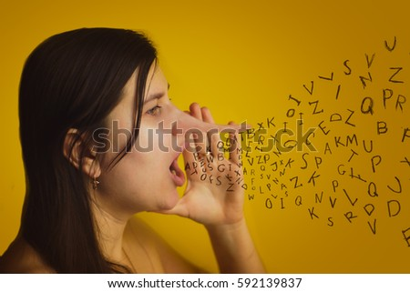 woman with long nose isolated on yellow wall background. She explores gossip and tells fake news . Liar concept. Human face expressions, emotions, feelings.