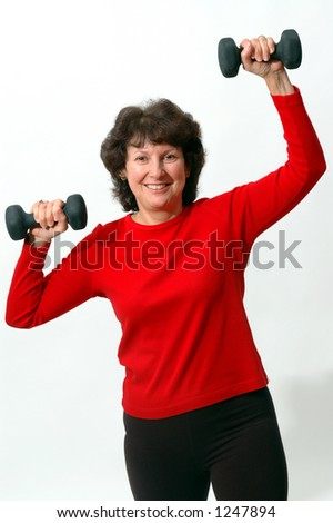 woman working with dumbbells - stock photo