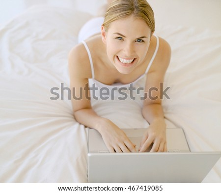 woman working with laptop in the bed