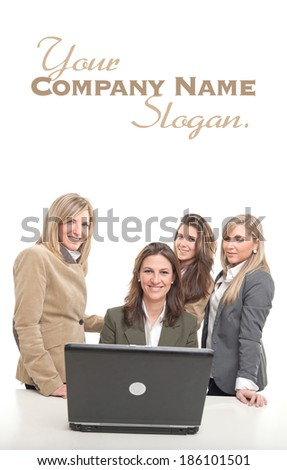 4 women around a desk with computer with happy faces  - stock photo