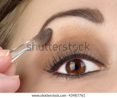 Women eye with brown makeup - stock photo