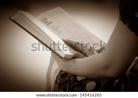 Women hand open book for reading, concept background