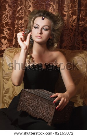 Wonderful woman with a key in a hand - stock photo