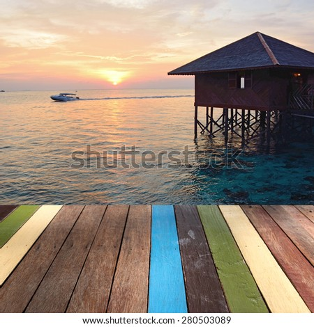 Wood table top on sea background montage concept - stock photo