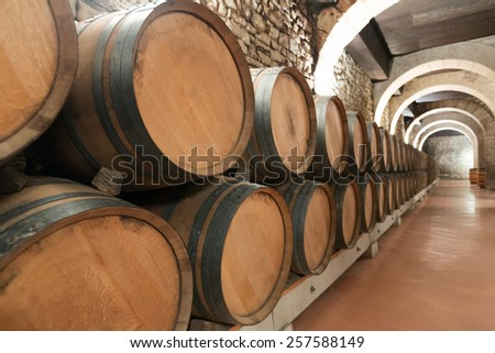 wooden barrels in old winery factory  - stock photo