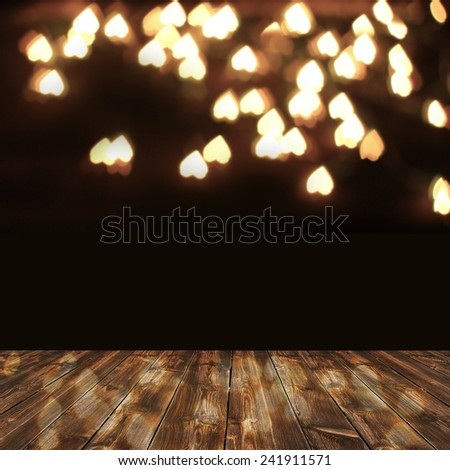 wooden deck table over heart bokeh background. Valentine's day background - stock photo