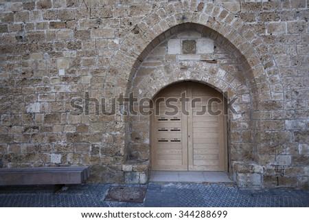 Wooden Door in Old City Wall  - stock photo