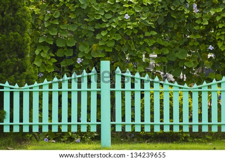 wooden fence in the grass. - stock photo