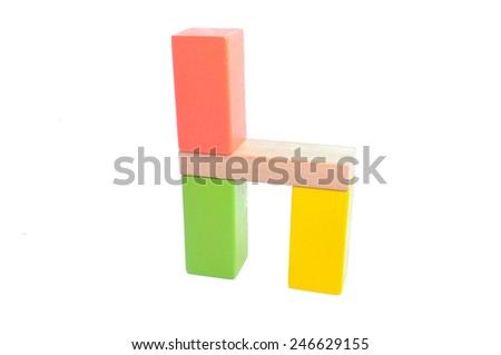 wooden geometric block cube isolated on a white background - stock photo