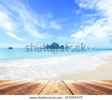 Wooden paving and beautiful beach. - stock photo