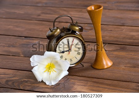 wooden Pinard stethoscope obstetric, white tulip and clock on wooden background - stock photo