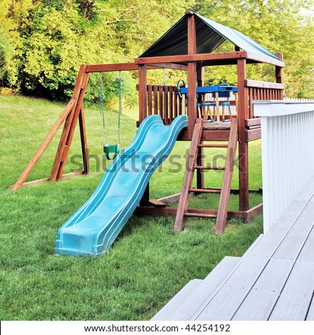 Wooden playset in a backyard - stock photo