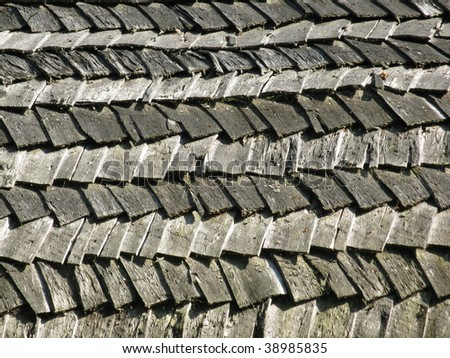 Wooden shingle roof as a background pattern - stock photo