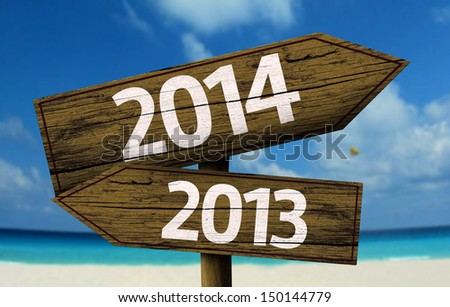 2013, 2014 wooden sign with a beach on background - stock photo