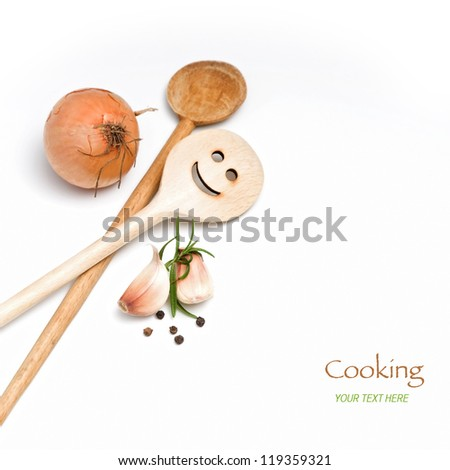 Wooden spoon with onion, garlic and spice - stock photo